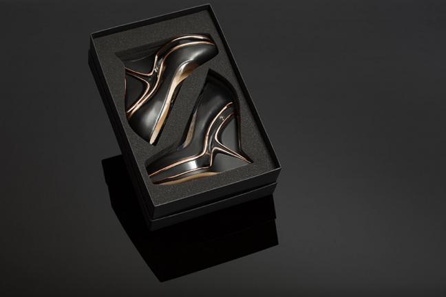Buty i torebka od Zaha Hadid Design
